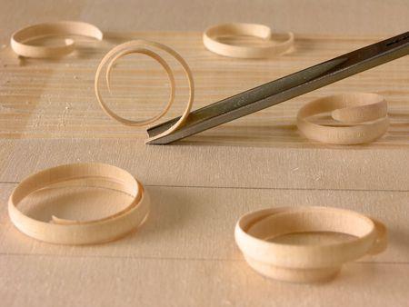 wood shavings: wood shavings and carving tool       Stock Photo