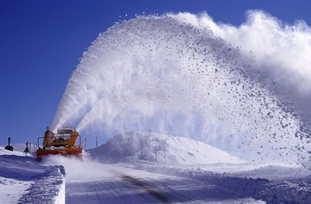 apennines: a snowplow in action on the apennines, italy