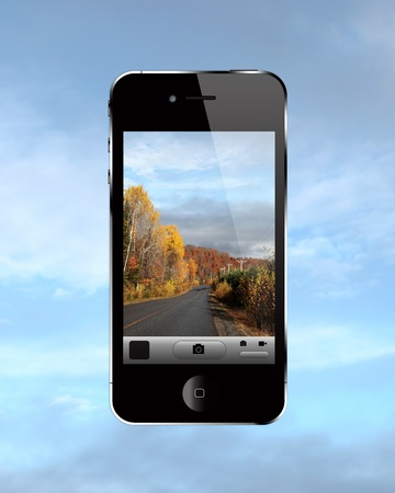 Modern touch screen cell phone with photo on screen. Stock Photo