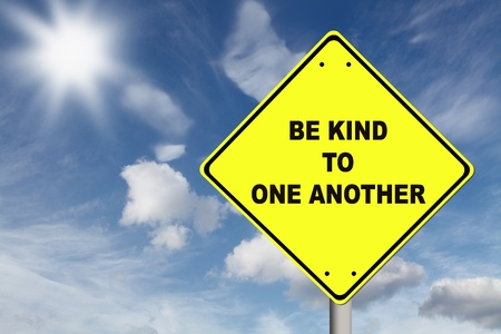 Be kind to one another yellow road sign