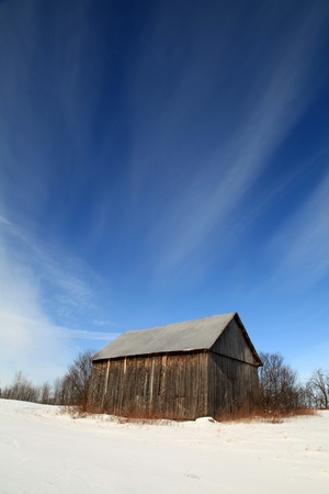 Bright winter morning in a field located in Quebec, Canada. photo