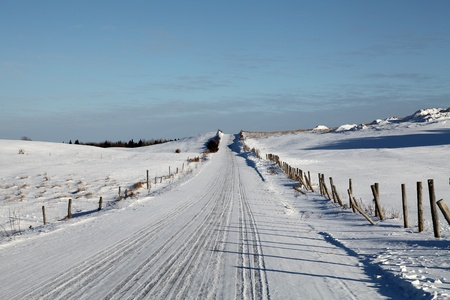Winter country road located in Quebec, Canada in the late afternoon Stock Photo - 12151273