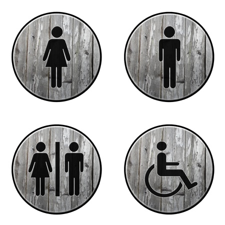 Round restroom signs on an old wood effect background Stock Photo - 12535029