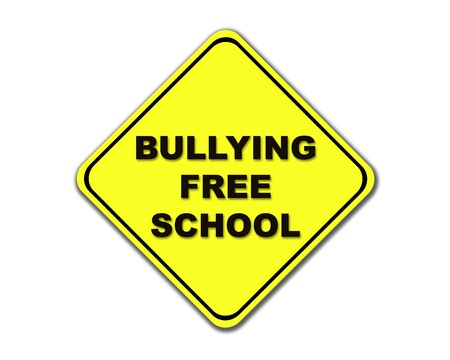 threat of violence: Yellow Bullying Free School road sign on a white background. Stock Photo