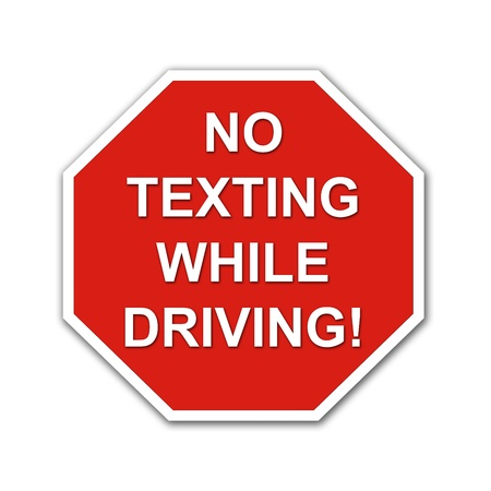 Red No Texting While Driving stop sign on a white background photo
