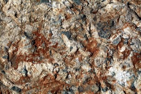 Multicolored rock surface photo