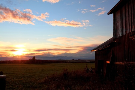 Beautiful sunset on a farm located in Quebec, Canada  photo
