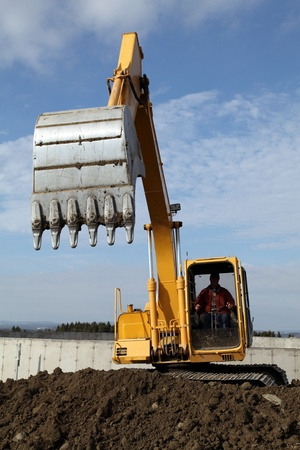 digger: Operating heavy equipment on a beautiful autumn day  Stock Photo