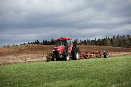 Ploughing on a cloudy spring day photo