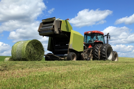 Rolling bales on a beautiful spring afternoon Stock Photo - 13998266