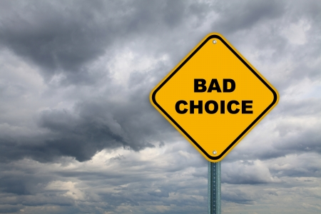 Yellow bad choice road sign on a cloudy sky background photo