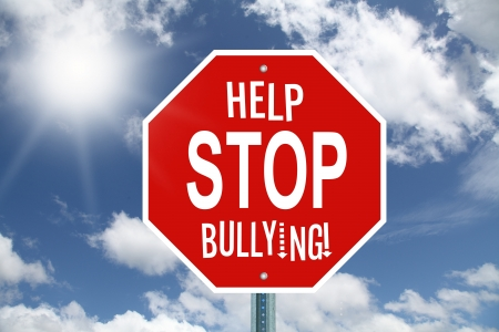 Red help stop bullying stop sign on sky background photo