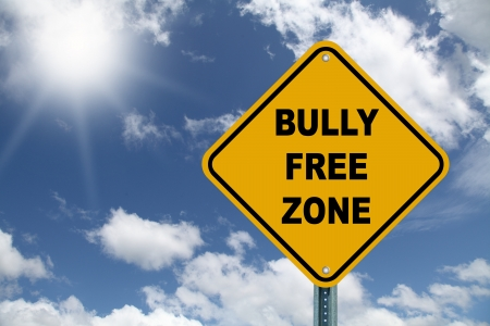 Yellow bully free zone road sign on beautiful sky background photo