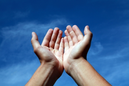 Hands offering towards the sky photo