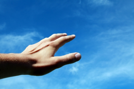 aspirational: Hand moving up towards the sky