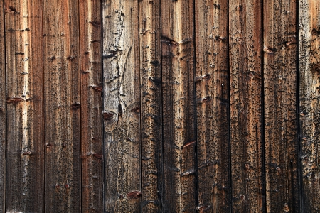 Old wood pboards on the side of an abandoned barn  photo