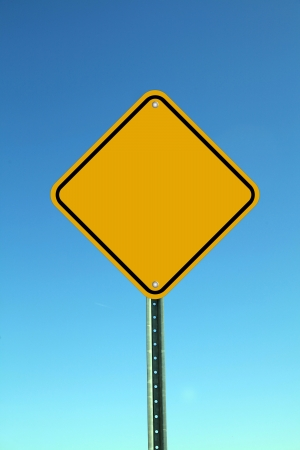 Blank road sign against blue sky photo