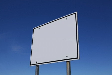 Blank white sign against blue sky photo