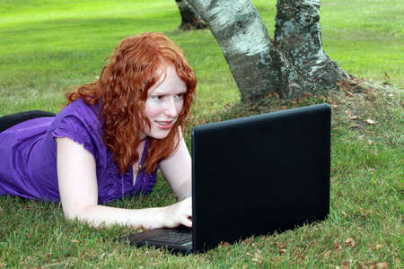 Young woman surfing on the internet photo