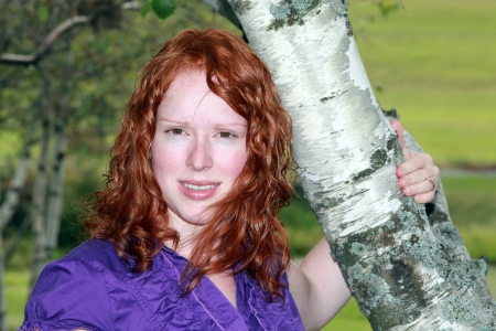 Young red headed woman posing for the camera