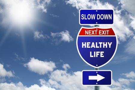 健康的な生活の次の出口が遅く動機付けの高速道路の道路標識 写真素材