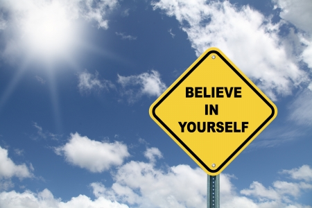 Yellow Believe in yourself cautionary road sign Stock Photo