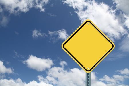 Blank yellow road sign on beautiful sky background photo