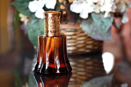 effusion: Fragrance Lamp on glass table Stock Photo