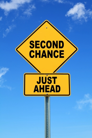 Yellow motivational road sign Second chance just ahead