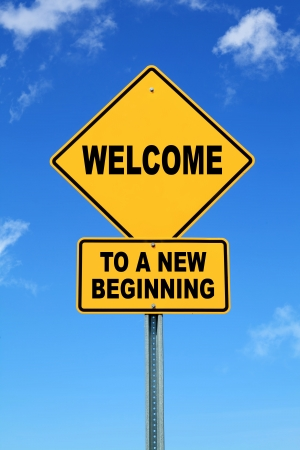new: Yellow Motivational road sign Welcome to a new beginning