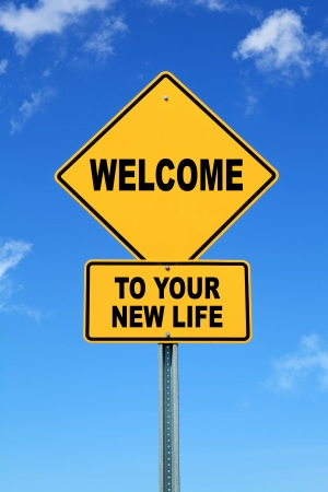 Yellow motivational road sign Welcome to your new life 免版税图像