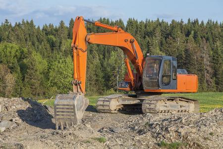 sand quarry: Orange excavator in quarry Stock Photo