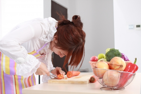 woman is cooking on a chopping block with various kinds vegetable  Stock Photo - 15289660