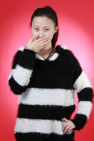 A Beautiful Chinese girl Isolated On red Stock Photo - 13458614