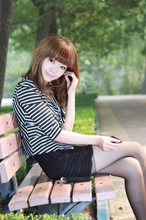A lovely asian woman in a park Stock Photo - 15349746