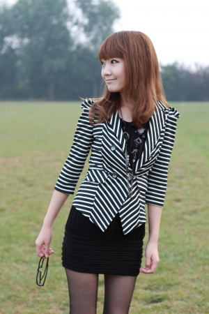 A lovely asian woman in a park Stock Photo - 15337998