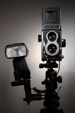 curio: A 120 double lens camera over a brown black background. Stock Photo
