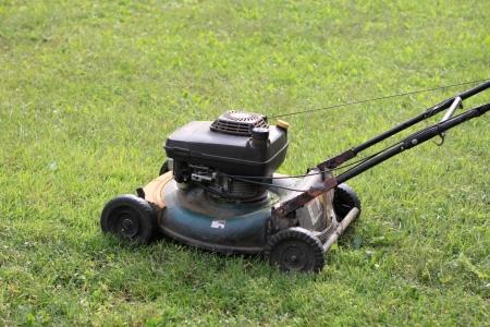 A grass cutter machine on the grassplot. photo