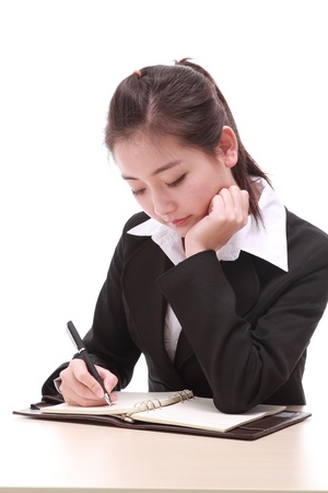young businesswoman with pen Stock Photo - 17284093