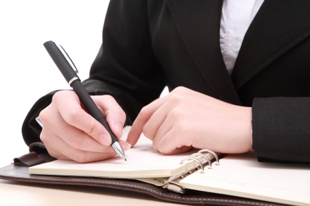 young businesswoman with pen photo