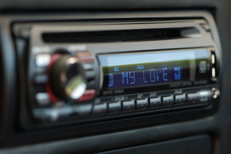 Black audio car control panel with my love blue writings.