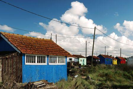 Multicolored shacks and wires near the ocean coast (Oleron  France) photo