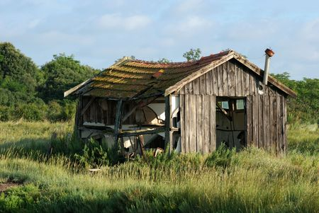 depraved: Abandoned shack lost in the meadow Stock Photo