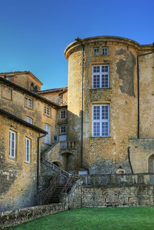 Part of a yellow castle under blue sky (TheizeFrance) photo
