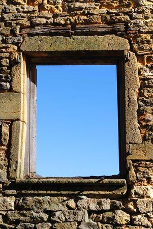 Sky view through a window/frame made in a stone facade. Stock Photo - 2139402