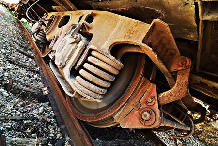 Grunge rusted polished train wheel and assembly on rail Stock Photo