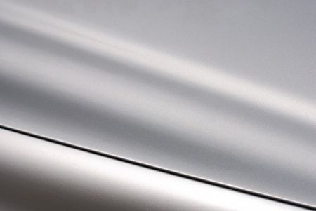 Silver chrome surface with a black line Stock Photo