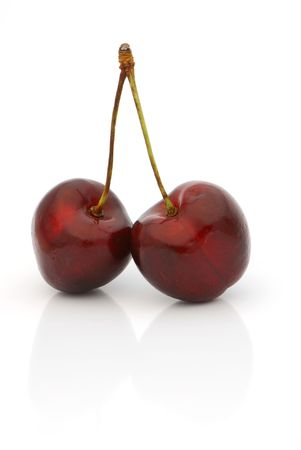 Close up view of two luscious cherries against white backgound Stock Photo