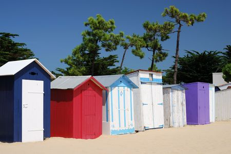 Brightly Coloured Beach Boxes on the seafront at St Denis beach (Ol�ronFrance). photo