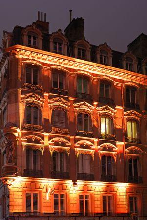 Orange illuminated night facade in old center city. Stock Photo - 2263826